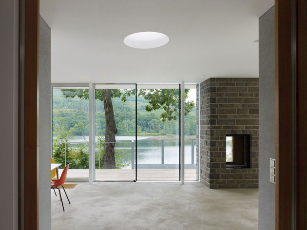 lake-house-above-rur-reservoir-germany-minimalist-masterpiece-5-fireplace.jpg