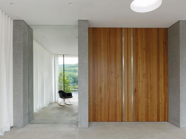 lake-house-above-rur-reservoir-germany-minimalist-masterpiece-7-living.jpg