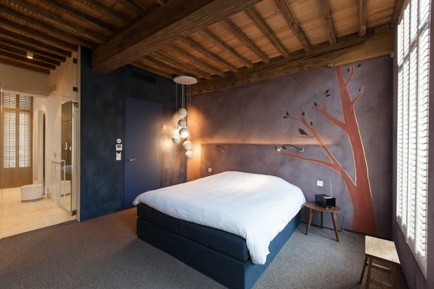 modern-rustic-inspiration-belgium-features-exposed-ceilings-6-dark-headboard.jpg