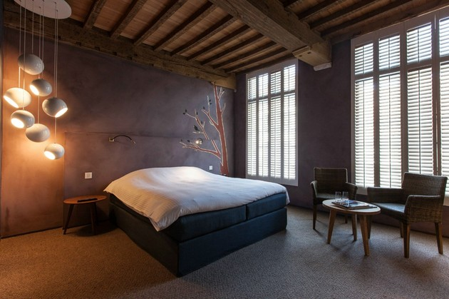 modern-rustic-inspiration-belgium-features-exposed-ceilings-7-dark-bedroom.jpg