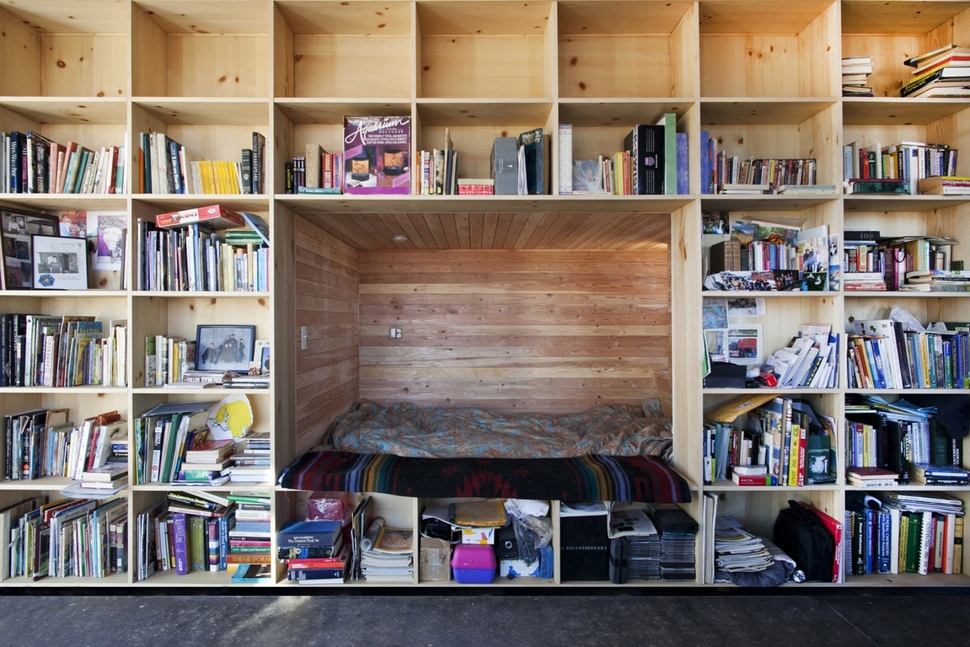 Nakai house in utah features wall of shelves with bedroom for Shelves in bedroom ideas