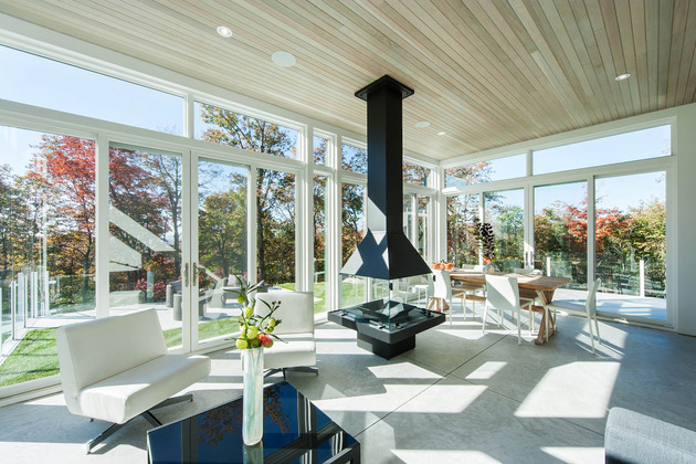 quebec-home-embraces-nature-with-glazing-and-open-interior-12.jpg