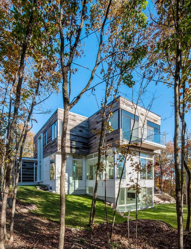 quebec home embraces nature with glazing and open interior 2 thumb 630x817 24516 Reclaimed Wood Exteriors and Interiors House