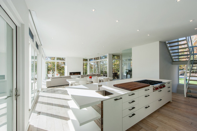 quebec-home-embraces-nature-with-glazing-and-open-interior-9.jpg