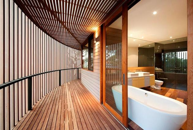 rectangular-wooden-house-with-slatted-circular-facade-9-bathroom.jpg