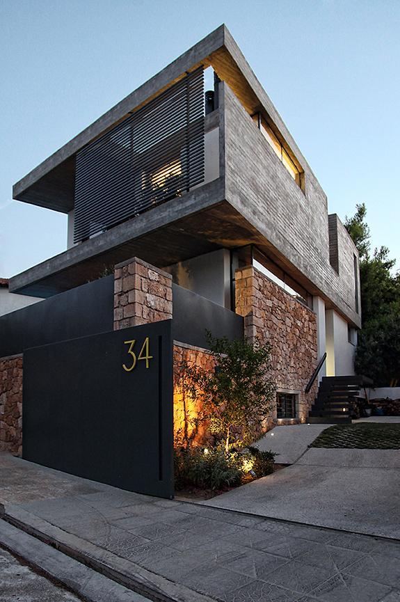 sleek athens house blends stone with concrete textures 1 facade angle thumb 630x947 26214 Sleek Athens House Blends Stone With Concrete Textures