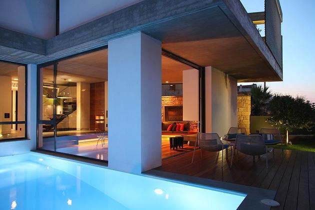 sleek-athens-house-blends-stone-with-concrete-textures-11-rear-deck-angle.jpg
