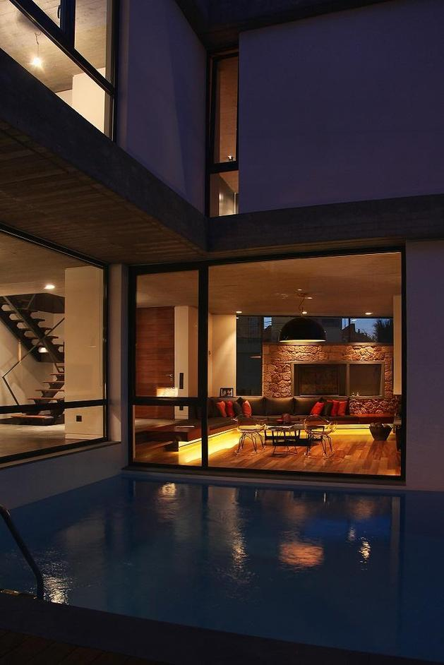 sleek-athens-house-blends-stone-with-concrete-textures-14-deck-inward-living-room.jpg
