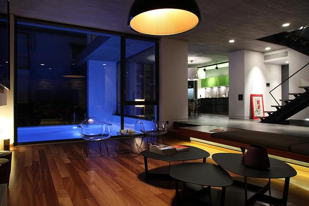 sleek-athens-house-blends-stone-with-concrete-textures-17-living-room-evening.jpg