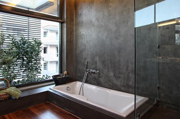 sleek-athens-house-blends-stone-with-concrete-textures-24-master-bath.jpg
