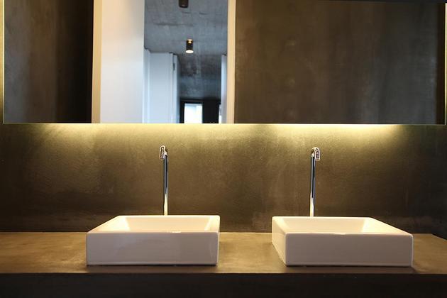 sleek-athens-house-blends-stone-with-concrete-textures-25-bathroom-sinks.jpg