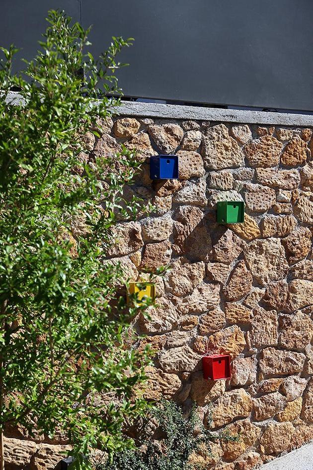 sleek-athens-house-blends-stone-with-concrete-textures-5-birdhouses.jpg