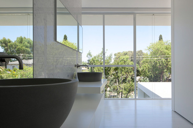 sleek-cubic-house-with-front-and-back-gardens-15.jpg