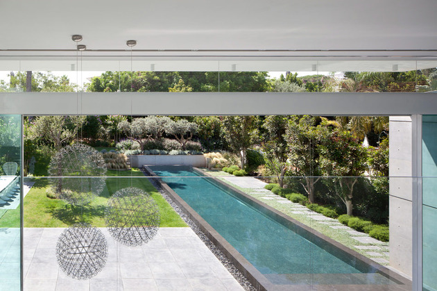 sleek-cubic-house-with-front-and-back-gardens-16.jpg