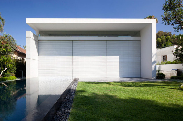 sleek-cubic-house-with-front-and-back-gardens-4.jpg