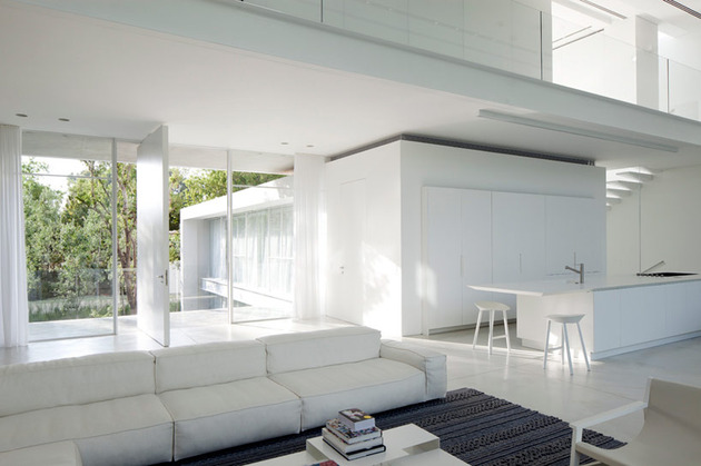 sleek-cubic-house-with-front-and-back-gardens-7.jpg