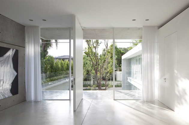 sleek-cubic-house-with-front-and-back-gardens-9.jpg