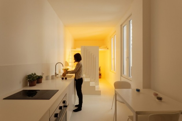 small-floorplan-paris-apartment-renovated-with-modern-lighting-solutions-5-evening.jpg