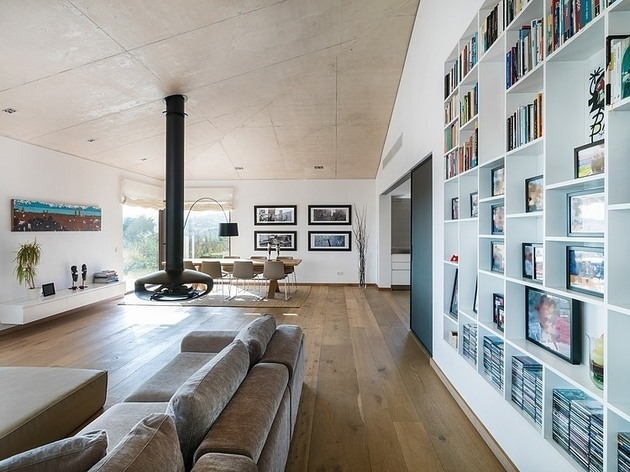 spanish-family-home-with-comfortably-contemporary-open-space-appeal-3-living-dining-straight.jpg