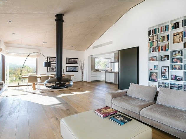 spanish-family-home-with-comfortably-contemporary-open-space-appeal-4-living-dining-angle.jpg
