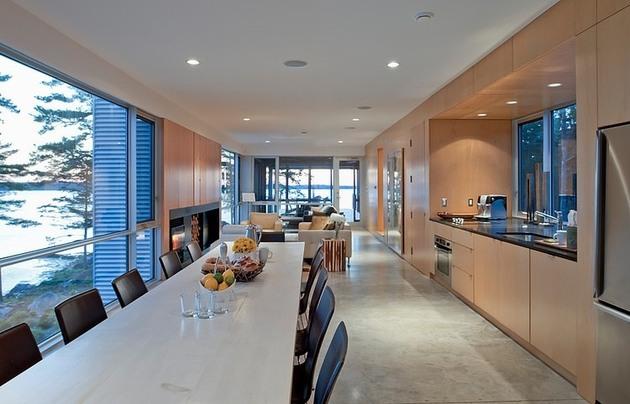 steel-wood-bridge-house-spans-2-seaside-rocky-outcrops-8-5-dining-kitchen.jpg