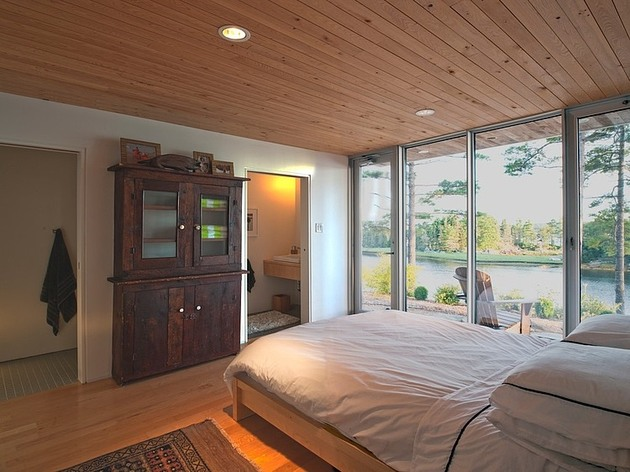 steel-wood-bridge-house-spans-2-seaside-rocky-outcrops-8-6-master-bedroom.jpg