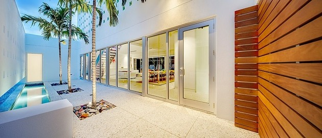 tall-private-florida-home-with-open-indoor-outdoor-hallways-15-inside-front-wall-night.jpg