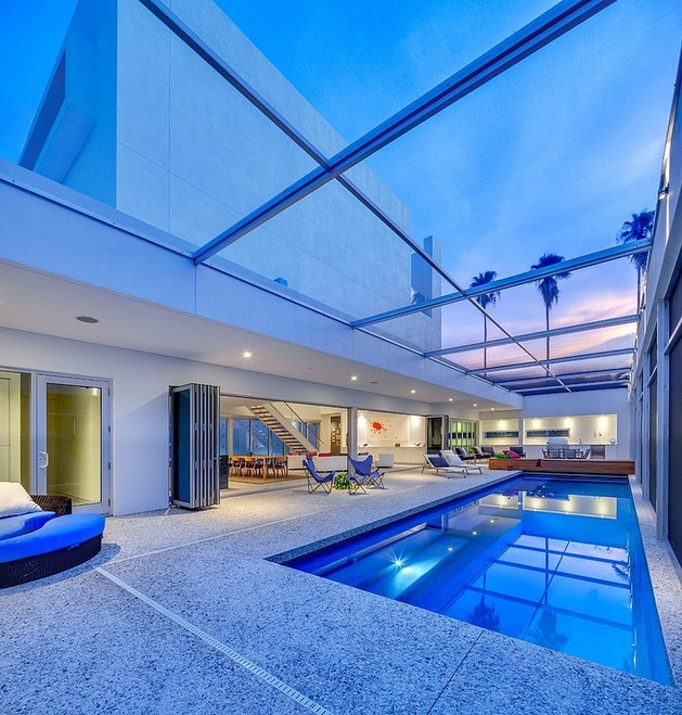 tall-private-florida-home-with-open-indoor-outdoor-hallways-17-pool-roof.jpg