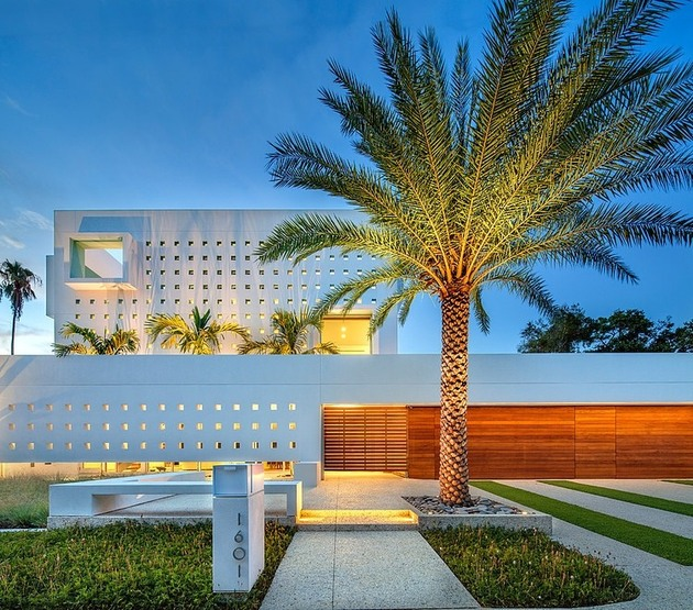 tall-private-florida-home-with-open-indoor-outdoor-hallways-3-entry-path-night.jpg