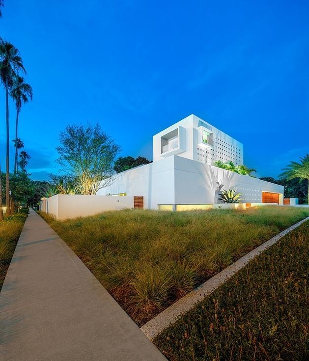 tall-private-florida-home-with-open-indoor-outdoor-hallways-4-left-front-corner.jpg