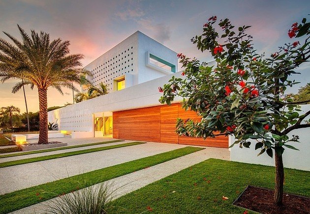 tall-private-florida-home-with-open-indoor-outdoor-hallways-6-right-front-corner-night.jpg