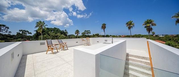 tall-private-florida-home-with-open-indoor-outdoor-hallways-9-top-deck.jpg
