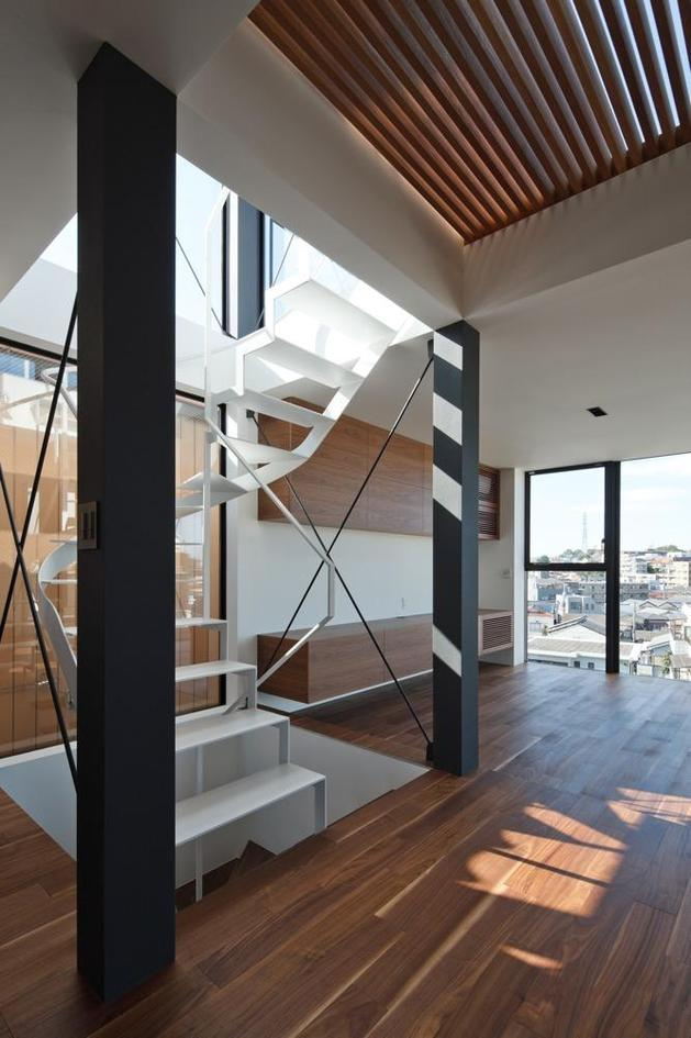 three-story-tokyo-house-with-panoramic-city-views-7-staircase-beam-angle.jpg