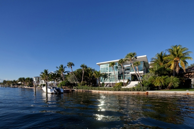 traditional-street-facade-hides-modernist-home-miami-lake-9-site.jpg