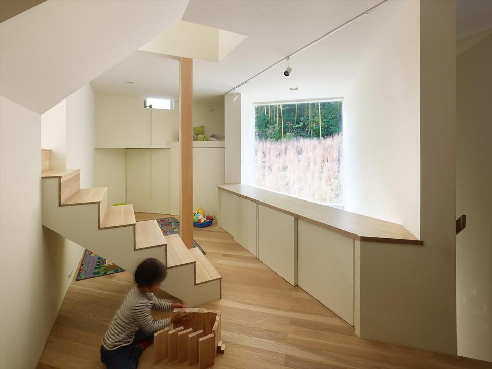 Triangular House With One Room And Mezzanines