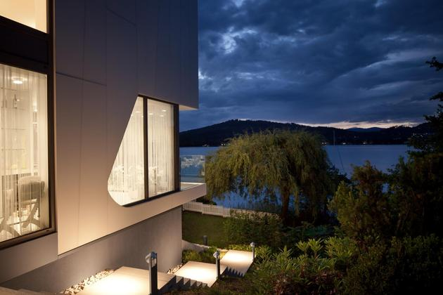 3-storey-home-addition-takes-advantage-dockside-views-17- facade night.jpg