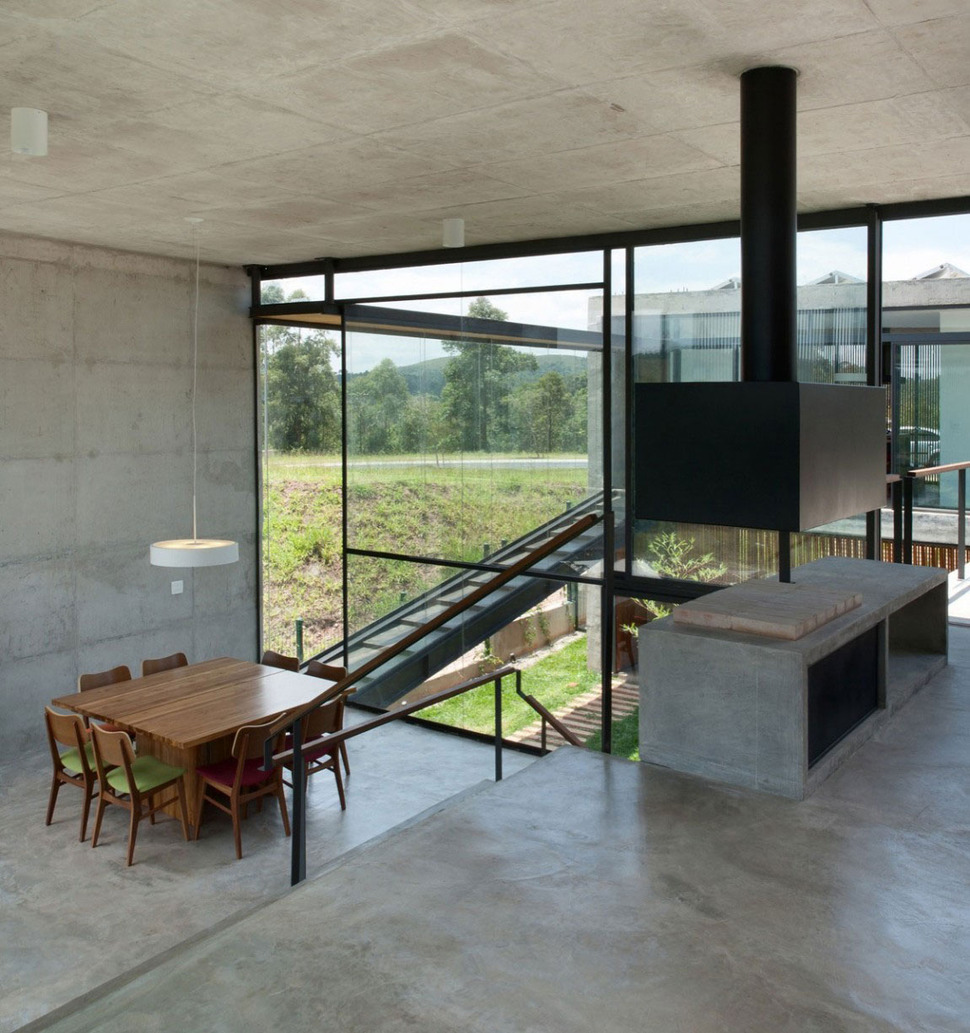 Concrete Home Interiors : Hillside house with concrete volumes nd story entrance