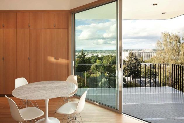 black-four-story-hillside-home-with-bridge-entry-path-8-deck.jpg