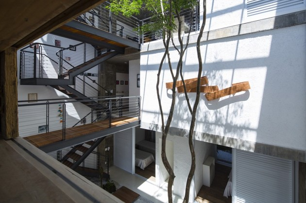 brazilian-concrete-house-built-around-three-story-courtyard-tree-12-second-level-courtyard-overlook.jpg
