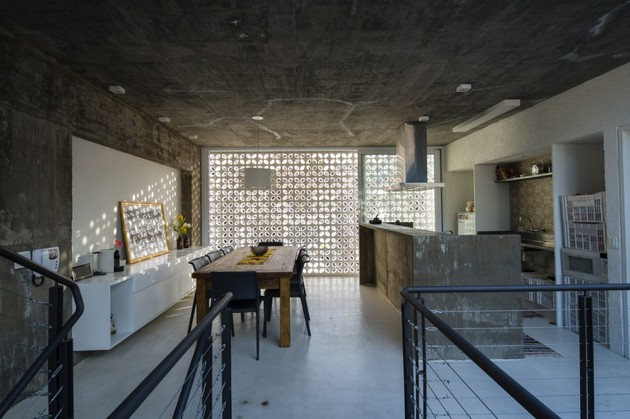 brazilian-concrete-house-built-around-three-story-courtyard-tree-15-into-kitchen.jpg