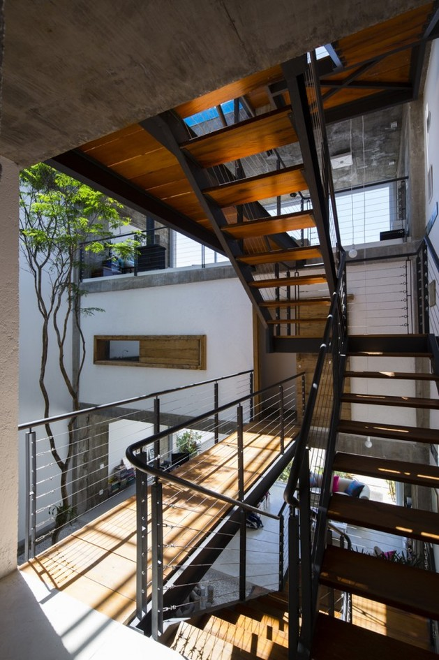 brazilian-concrete-house-built-around-three-story-courtyard-tree-5-second-level-stairs.jpg