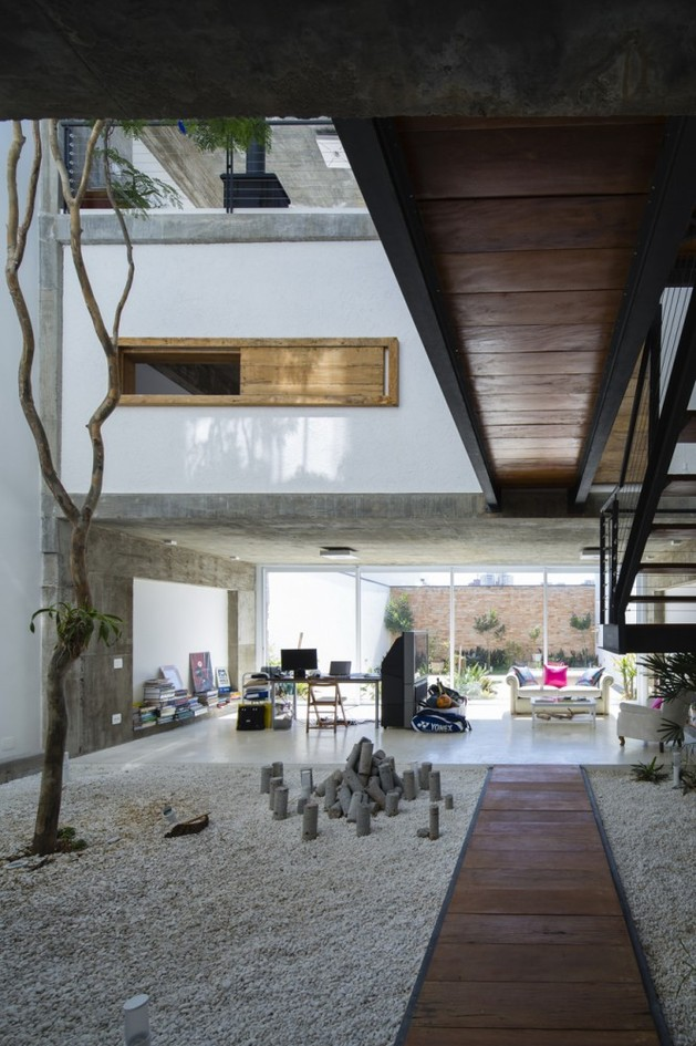 brazilian-concrete-house-built-around-three-story-courtyard-tree-8-ground-level-path.jpg