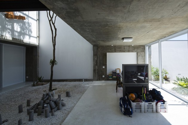 brazilian-concrete-house-built-around-three-story-courtyard-tree-9-ground-level-living-area.jpg