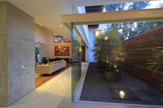 casa siete opens wide front back false façade 1 courtyard thumb 630x420 26767 Modern Concrete Villa with Beautiful Interior Courtyard