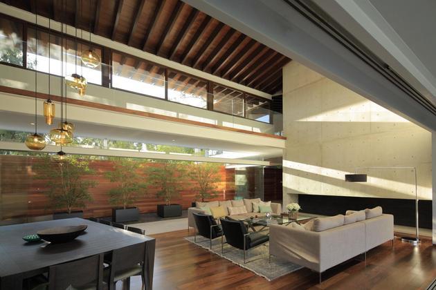 casa-siete-opens-wide-front-back-false-façade-11-living-dining.jpg