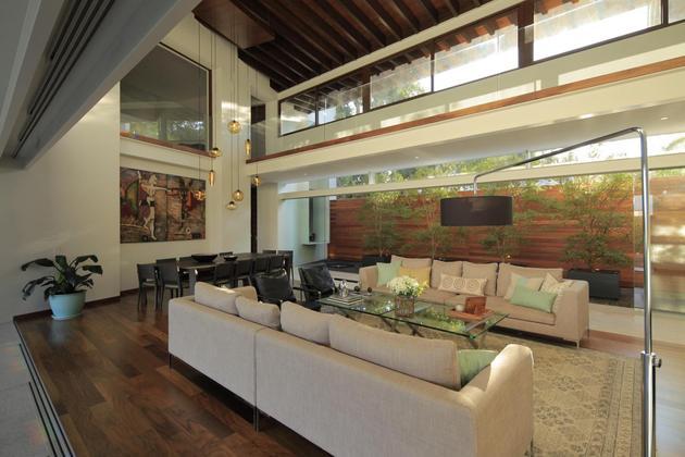 casa-siete-opens-wide-front-back-false-façade-12-living-dining.jpg