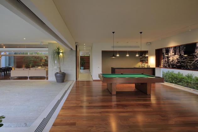 casa-siete-opens-wide-front-back-false-façade-13-games.jpg