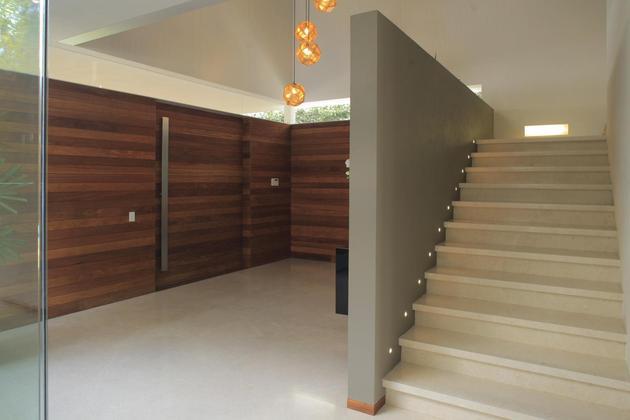 casa-siete-opens-wide-front-back-false-façade-16-foyer-steps.jpg