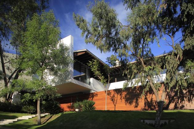 casa-siete-opens-wide-front-back-false-façade-3-façade.jpg