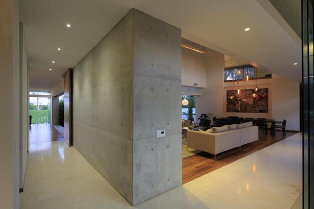 casa-siete-opens-wide-front-back-false-façade-8-hall.jpg